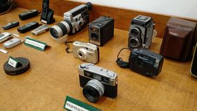 Old and classic photographic machines, camera and cell phones Stock Images