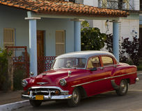Old Classic Red Car in Cuba. Lovely old red car parked in front of traditional house in Vinales, Cuba Royalty Free Stock Photos