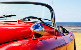 Old classic red jaguar at beach. Old american classic red jaguar at beach stock image