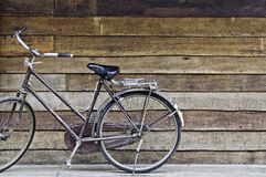 Old classic style bicycle park on old rough texture wood stripe. Floor and wall in background Royalty Free Stock Photos