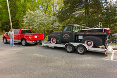 An old classic truck on a trailer in the united states Stock Images