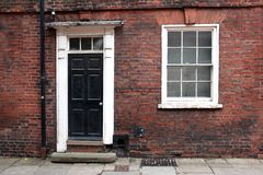 Old classic victorian door. And window in England Royalty Free Stock Photography