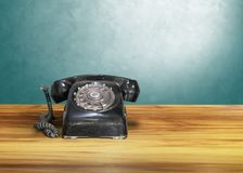 Old classic vintage dial telephone on wooden table. Communication Royalty Free Stock Images