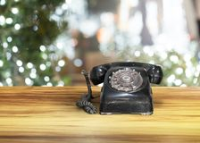Old classic vintage dial telephone on wooden table. Communication Royalty Free Stock Image