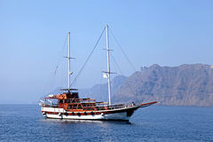 Old classic wooden sailboat in Santorini island, Greece Stock Images