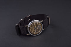 Old classic wristwatch for man on black background Royalty Free Stock Image