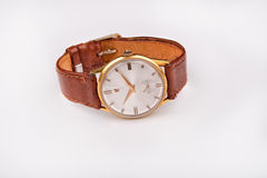 Old classic wristwatch for man with brown strap on white Stock Photography