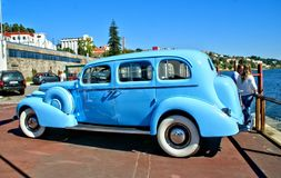 Old classical blue car near Douro river royalty free stock images