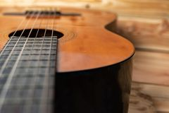Old classical guitar on wooden background stock photography