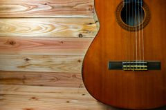 Old classical guitar on wooden background royalty free stock photos