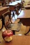 Old classroom and apple Royalty Free Stock Photos