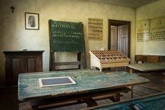 An old classroom with blackboard and boards with old script royalty free stock photo