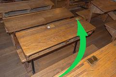 Old classroom with school desks. And a green arrow. Concept Continuing education, pass an exam the high school Stock Photo