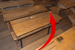 Old classroom with school desks. And a red arrow. Concept failure, examination to the high school failed Stock Images