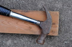 Old Claw Hammer. Old hammer with a two by four piece of lumber Stock Photography