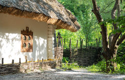 Old clay house with straw roof Stock Photography