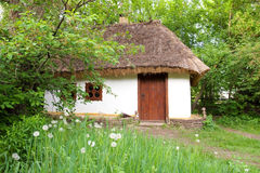 Old clay house with straw roof Royalty Free Stock Photography
