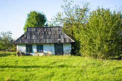 Old clay house with a wooden roof Stock Images