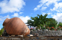 Old clay jars 3. Ancient clay pots against a blue sky and white clouds stock photo