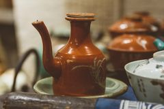 Old clay jug in antique shop in China royalty free stock photo