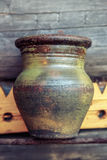 Old clay jug on wooden Royalty Free Stock Photography