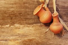 Old Clay Jugs Garland in Grunge wood background, XXXL Stock Image
