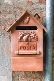 Old clay mailbox in Italian town. Orange mailbox. Close up. stock images