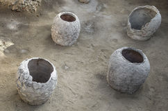 Old clay pot excavations into ancient city ruins. Under sunlight Royalty Free Stock Photo
