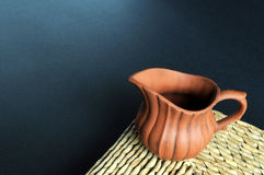 Old clay pot on grass mat. An old clay pot of Chinese tea set on grass mat Royalty Free Stock Image