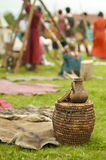 Old clay pot on wooden basket Stock Image