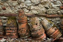 Old clay pots. Near stone wall royalty free stock photography