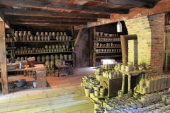 Old clay pots on display in potters building,Old Sturbridge Village,September,2014 Royalty Free Stock Photo