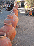 Old Clay Pots Lined up in a Traditional Village Royalty Free Stock Image