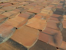 Old clay roof shingles. Old clay shingles lying on the roof for a background royalty free stock image