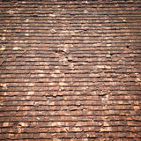 Old clay roof. Which crack and ruin in close up Royalty Free Stock Image