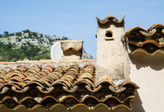 Old Clay Tile Roof and Plaster Chimney Royalty Free Stock Photos