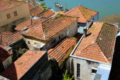 Old clay tiled roofs of Porto, Portugal Stock Images
