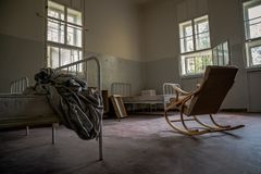 An old clinic with poor patient conditions. Neglected hygiene, field conditions. Psychiatric hospital, interior, medical, room, background, building, corridor stock photos