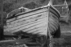 An old clinker built wooden working fishing boat on a trailer Royalty Free Stock Image