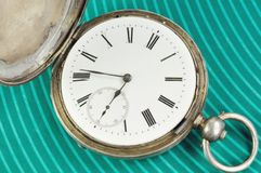 Old clock. Against green background Stock Photo
