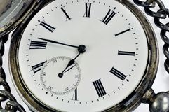 Old clock. Against white background Stock Photo