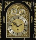 An old clock. With beautiful decorations Stock Photos