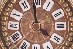 Old clock. Old golden clock face close-up Royalty Free Stock Photography