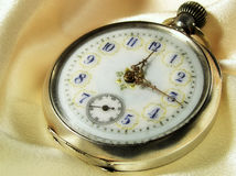 Old clock. Old pocket watch on silk Royalty Free Stock Photo