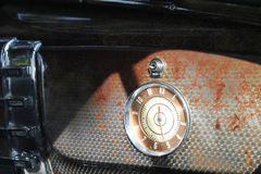 Old clock on american car glove box Stock Photos