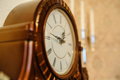 Old clock. Antique wooden vintage wall clock  on backgroun Royalty Free Stock Photos