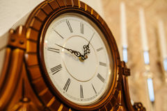 Old clock. Antique wooden vintage wall clock  on backgroun Stock Images
