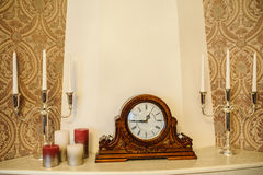 Old clock. Antique wooden vintage wall clock isolated on backgroun Royalty Free Stock Photos