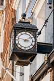 Old clock on the avenues of London Stock Image
