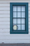 Old Clock behind Window Stock Images